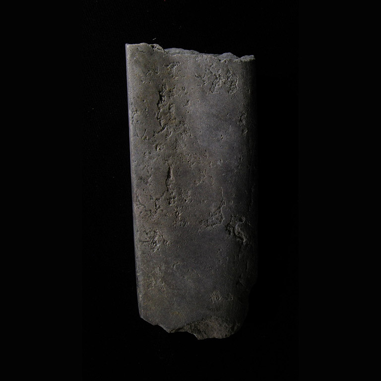 One piece of stone shaped into a flat square piece with a slight groove down the centre.